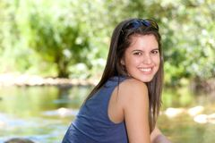 Friendly young woman smiling outdoors Royalty Free Stock Photos