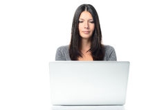 Friendly Young Woman Using Laptop Royalty Free Stock Images