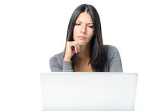 Friendly Young Woman Using Laptop Royalty Free Stock Image