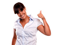 Friendly young woman with a winning attitude Stock Photos