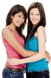 Friends 1. Two pretty young women holding each other Stock Image