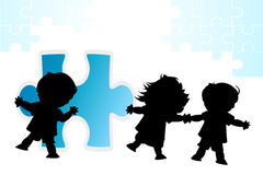 Friends. Children trying to make a puzzle Royalty Free Stock Images