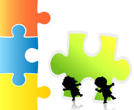 Friends. Children trying to make a puzzle Stock Photos