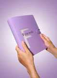 Friends. A woman holding a friends photo book Royalty Free Stock Photos