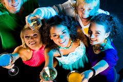 Friends. Above angle of happy friends cheering up at party royalty free stock image