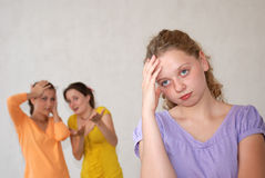 Friends?. Emotional scene with three teenagers Royalty Free Stock Images