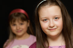 Friends. Portrait of a young girl with a girl friend standing in the background Stock Photo