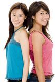 Friends 2. Two pretty young woman stand back to back Stock Photography