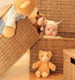 Friends 2. A baby and the group of teddy bears are sitting in backets Stock Photography
