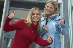 Friends. Two young blond women standing on stairs Royalty Free Stock Images