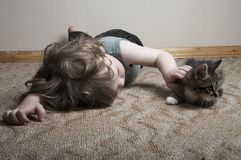 Friends. Little adorable boy with  kitten playing at home Royalty Free Stock Photography