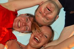 Friends. Three friends are laughing together Royalty Free Stock Images
