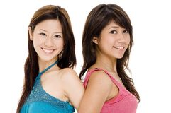 Friends 3. Two close young asian woman in colorful tops Stock Images