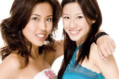 Friends 3. Two pretty young asian women on white background Royalty Free Stock Photo