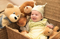 Friends 3. A baby and the group of teddy bears are sitting in baskets Stock Photo