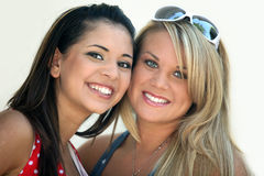 Friends. Two smiling girl friends - blond and brunette Royalty Free Stock Photos