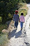 Friends. Two children walking hand in hand Stock Images
