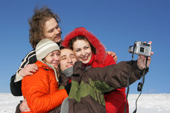 Friends. Four friends taking a selfportrait in winter Stock Photography