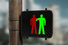 Friends. Traffic light and two figures shaking hands on it Stock Photography