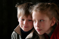 Friends. A couple of children against a black background Stock Photo
