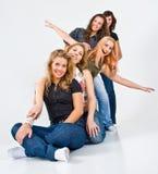 Friends. Teenage girlfriends having fun in a studio Royalty Free Stock Images