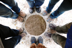 Friends. Group of feet in sneakers around the cave Royalty Free Stock Photo