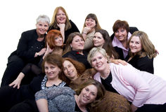 Friends. A large group of women having fun together. Friends sharing a drink Stock Photography
