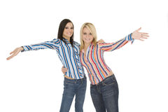 Friends. Female Caucasian friends acting silly on white background Royalty Free Stock Photos