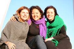 Friends. Three girls sitting next to each other Stock Photography
