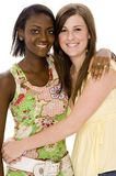 Friends. Two attractive young women on white background Royalty Free Stock Photography