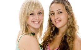 Friends. Two attractive teenage women with great smiles on white background Stock Image