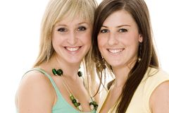 Friends. Two attractive young women smiling on white background Stock Images