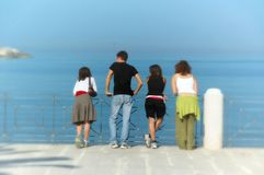 Friends. Talk in front of the sea Royalty Free Stock Image