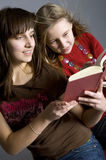 Friends. Two teenagers read the book Royalty Free Stock Photo