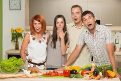 Friends acting surprised while cooking Stock Photo