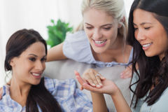 Friends admiring brunettes engagement ring Stock Images