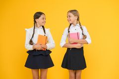Friends adorable pupils. Schoolgirls formal style school uniform. Education is step by step process of getting knowledge stock photos