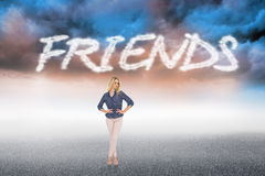 Friends against cloudy landscape background Royalty Free Stock Image