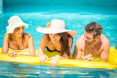 Friends on airbed. Friends having fun in water with airbed stock images