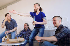 Friends argue about football match Stock Image