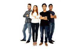 Friends with arms folded standing together Royalty Free Stock Images