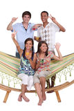 Friends around a hammock Stock Photo