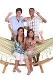 Friends around a hammock Stock Photo