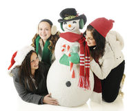 Friends Around the Snowman royalty free stock photo