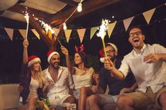 Free Friends At An Outdoor New Year`s Eve Party Stock Photos - 130536223
