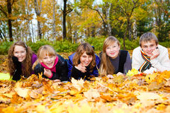 Friends on autumn leaves royalty free stock photos