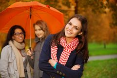 Friends in autumn park Royalty Free Stock Image