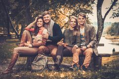 Friends in autumn park Royalty Free Stock Photography
