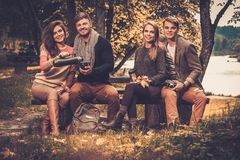 Friends in autumn park Royalty Free Stock Photos