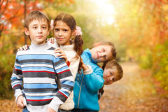 Friends in an autumn park. Group of a school aged friends in an autumn park Royalty Free Stock Photo